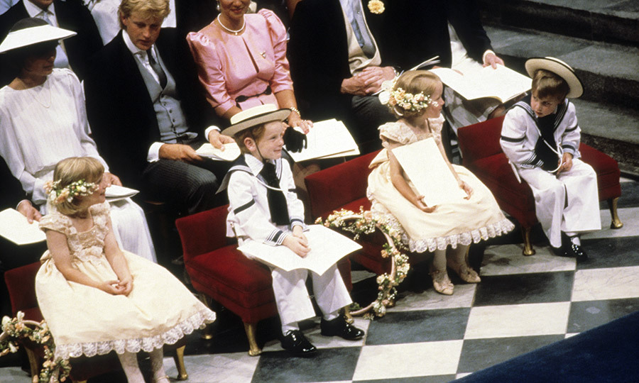 "The wedding attendants – page boys in sailor suits and flat brimmed hats, and flower girls in peach lace dresses with blossoms in their hair –  included adorable <a href=""https://us.hellomagazine.com/tags/1/prince-william/""><strong>Prince William</strong></a>, far right, who had just turned four in June. 
