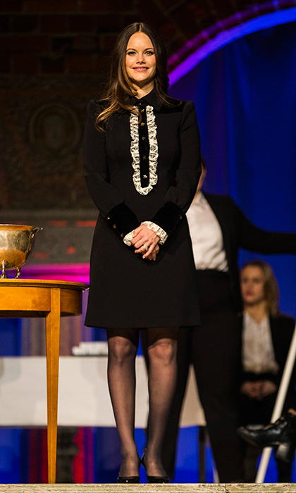 Princess Sofia of Sweden looked sweet in a black shirt dress with contrasting white ruffles at the Sophiahemmet college graduation ceremony at Stockholm City Hall on January 18. 