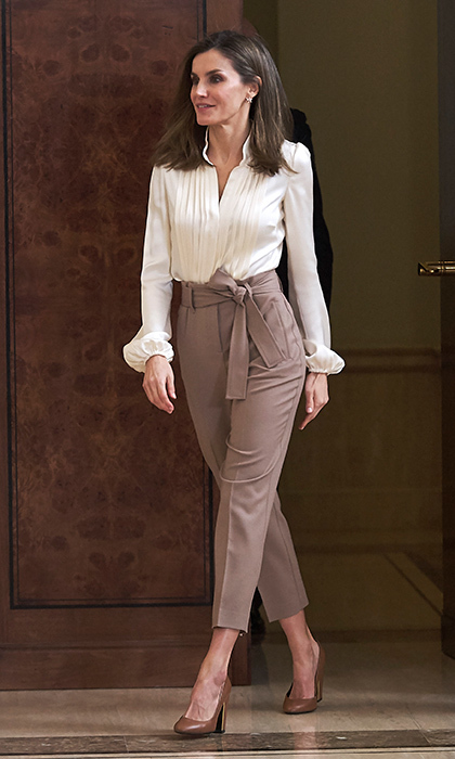 "Queen Letizia of Spain was walking tall in pleated <a href=""https://us.hellomagazine.com/fashion/02018011641576/royals-who-have-made-a-statement-wearing-trousers""><strong>trousers</strong></a> and a silky cream-colored blouse at the Zarzuela Palace on January 23 in Madrid.