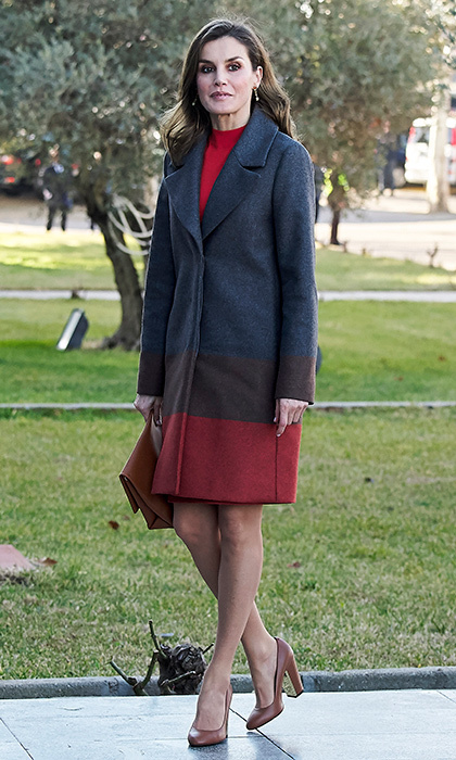 Queen Letizia wore an ombré color block look in grey and red as she headed to the Joma Sport factory on January 19 in Portillo de Toledo, Spain.