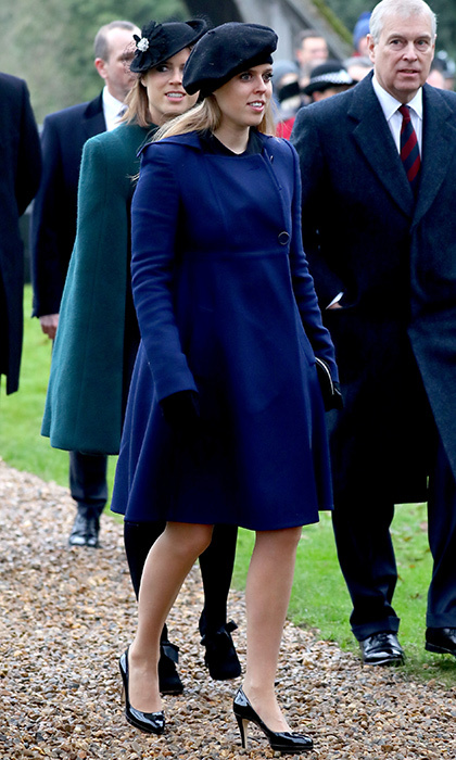 Eugenie's sister Princess Beatrice also was spotted at the Norfolk service, wearing a bold blue coat, black beret and patent leather heels.