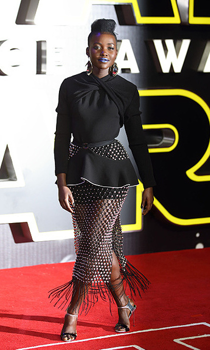 December 2015:  Lupita stunned at the European premiere for <i>Star Wars</i>. The beaded skirt is sci-fi fabulous as is her bold blue lipstick.