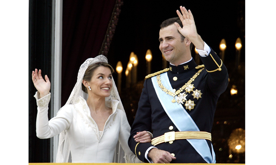 Following the street procession the newlyweds arrived at the Royal Palace. After hours of rain, the sun finally broke through as Felipe and Letizia came out onto the balcony to greet thousands of cheering royal fans in Madrid's Plaza Oriente below. Despite tradition the couple chose to forego a kiss in front of the the public.