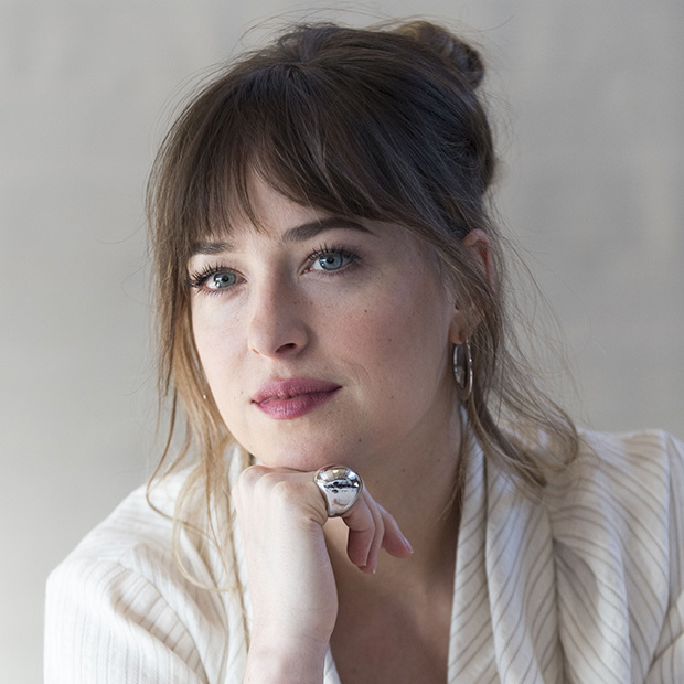 Dakota Johnson wore a casual updo with wispy side bangs at the press conference for <I>50 Shades Freed</I> in Hollywood in January 2018.