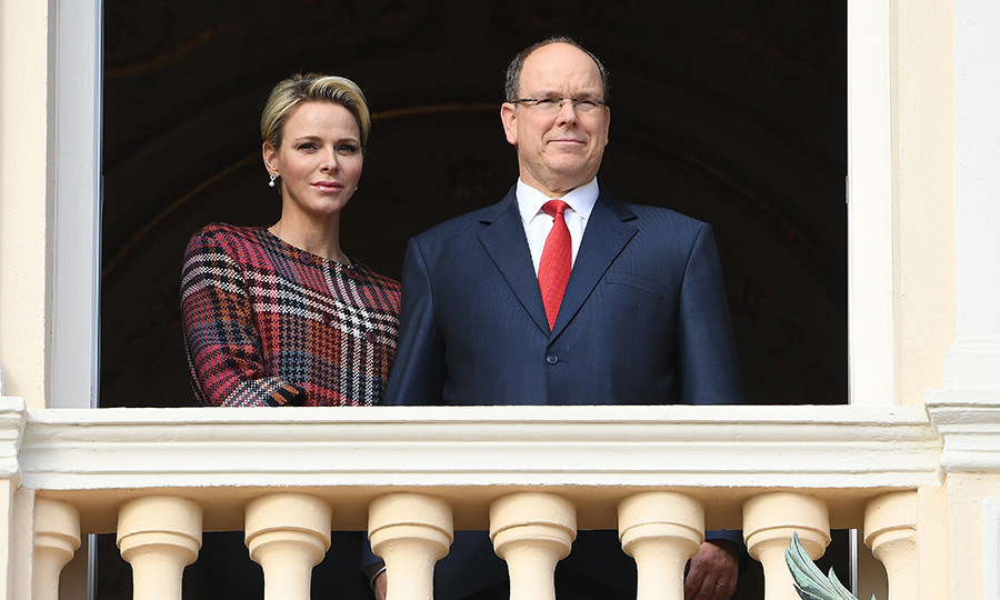 Royal couple Princess Charlene and Prince Albert II of Monaco, held hands as they overlooked the festivities for Sainte-Devote from the balcony of the Princely Palace. 