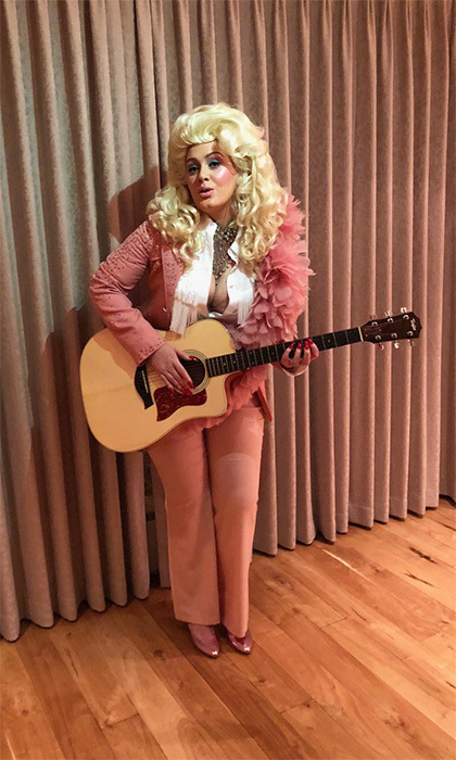 "Adele took to Instagram on January 29 to share her love for legendary country singer Dolly Parton. The <i>Hello</i> singer donned Dolly's traditional pink ensemble, popping on her iconic blond hair. She captioned the image, ""The effortless queen of song, Dolly Parton! We love you! We wish We could possess an ounce of your ability. You were the hero of our night! A hero of my life. I'll always love you x.""