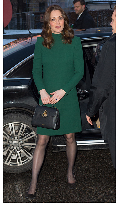 Underneath her coat, Kate wore a another Catherine Walker creation – a  green over-the-knee, long-sleeved dress. 