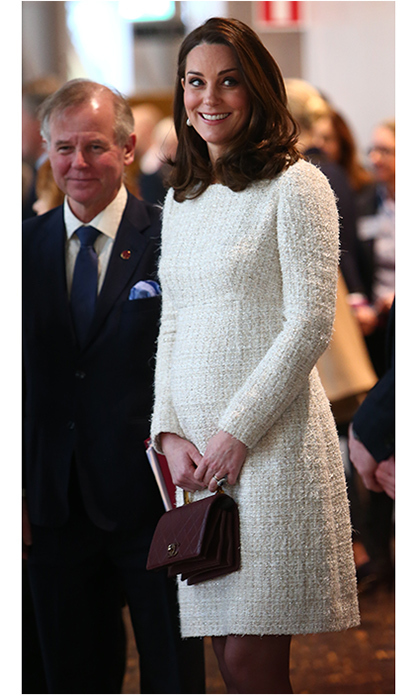 Once inside, the Duchess removed her coat to reveal a stunning off-white bouclé dress from Alexander McQueen. 