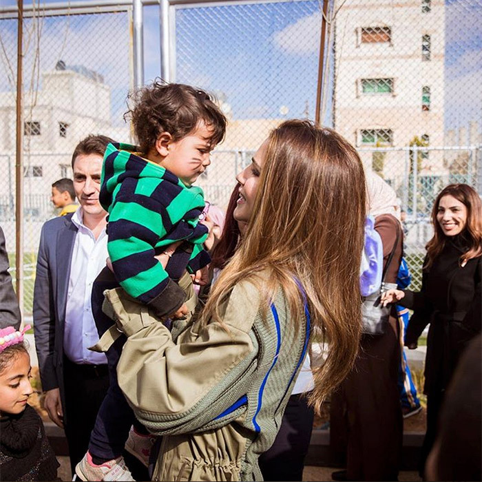 Queen Rania of Jordan shared this sweet photo of her visit with a group of children and their parents at the inauguration of Al Mustanadeh Park in Al Qweismeh.