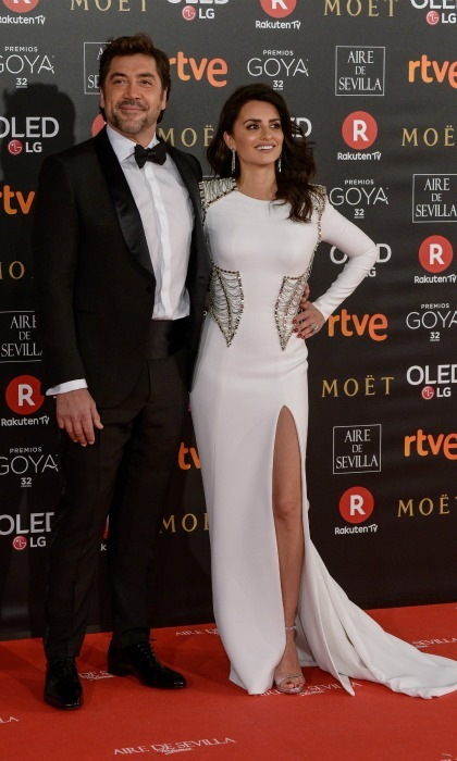Glamorous date night! Penélope Cruz and Javier Bardem made for a gorgeous couple at the 2018 Goya Cinema Awards in Madrid, Spain, on Saturday, February 3, as they walked the red carpet together. Penelope, who plays Gianni Versace's sister Donatella in FX's new show <i>The Assassination of Gianni Versace: American Crime Story</i>, wore the designer to the outing. She rocked a long-sleeved gown design in white which flowed down to the floor.