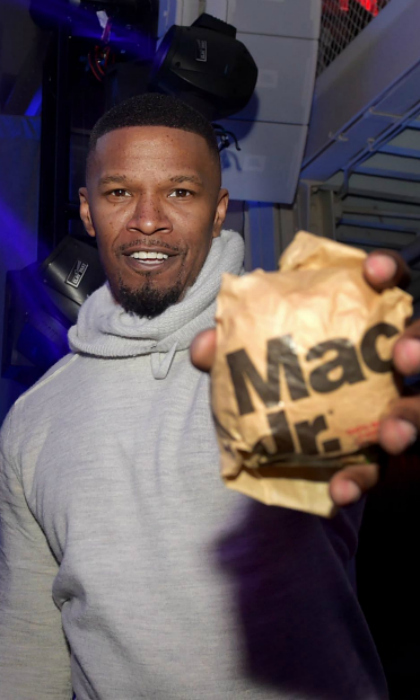 "Ba da ba ba ba! Jamie Foxx is lovin' it. The 50-year-old actor attended Bootsy Bellows' 6th annual ""Big Game Experience"" presented by The h.wood Group, American Airlines & Casper at The Machine Shop in Minneapolis on Friday, February 2. Guests, including Jamie, enjoyed tasty McDonald's menu items that were served throughout the day and into the night in celebration of football's most exciting weekend.