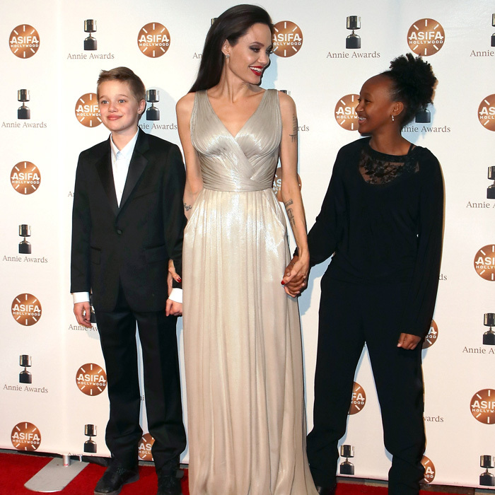 Angelina Jolie brought Shiloh and Zahara with her to the Annie Awards at Royce Hall. The trio has been quite the world travelers venturing to Jordan to visit a Syrian refugee camp then to Paris and now back home in L.A.