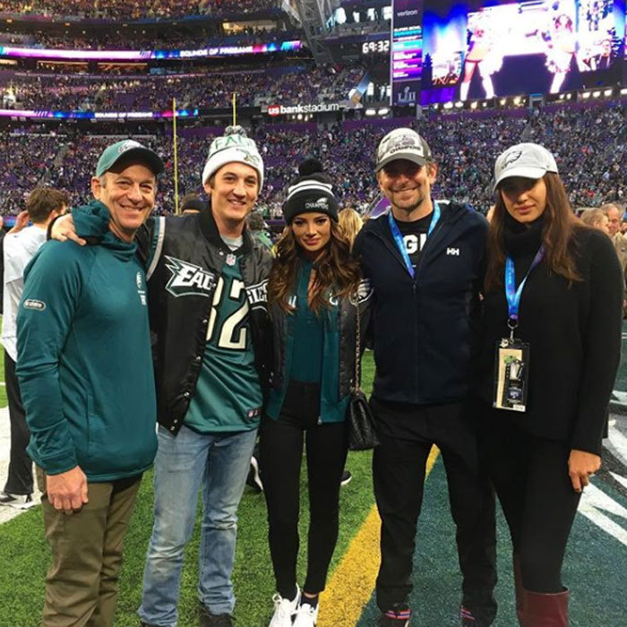 Eagles superfan Bradley Cooper and Irina Shayk joined Miles Teller and his fiancée Keleigh Sperry on the field ahead of the Super Bowl. Throughout the game, cameras captured the <i>Hangover</i> star's animated gestures as he watched from a box with Irina Shayk.
