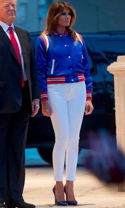The first lady wore a patriotic, leather-trimmed silk-satin bomber jacket in red white and blue by AMIRI ($2,100), which she paired with white J Brand jeans and stilettos to watch the Eagles and Patriots play at a viewing party held at the Trump International Golf Club in West Palm Beach on February 4.