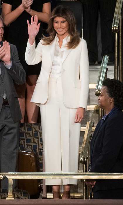 The smiling first lady wore a pantsuit in crisp white on January 30 for her husband's first State of the Union address. Melania opted for a white Dior suit and Dolce & Gabbana blouse for the occasion, completing the ensemble with her signature Christian Louboutin pumps.