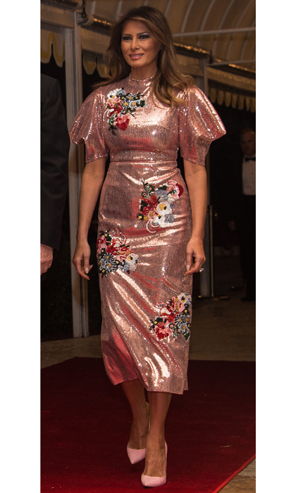 Melania Trump rang in 2018 at Mar-a-Lago in Palm Beach, Florida. For the festivities, the president's wife sparkled in an embroidered satin midi dress by one of Kate Middleton's favorite designers, Erdem. The pink design, which according to Vogue Australia originally retailed for just over $7000, featured fluttering sleeves and beaded floral bouquets. The first lady teamed the piece with her signature stilettos, wearing bubblegum pink Louboutins to match her dress.