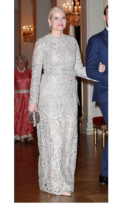 The royal who has been compared to Queen Elsa in <I>Frozen</I>, Crown Princess Mette Marit of Norway, looked elegant in an icy silver lace gown to dine with Duchess Kate and Prince William at the Royal Palace in Oslo.