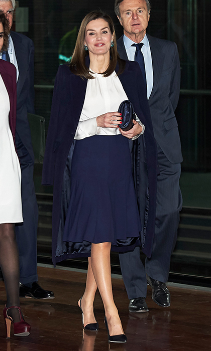 Queen Letizia of Spain opted for classic navy blue at the 6th Cancer Forum at the Reina Sofia Museum in Madrid on February 1.