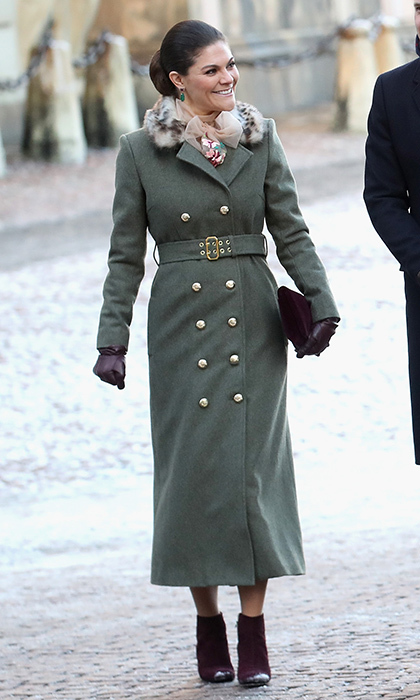 Sweden's future Queen was chic once again in a double-breasted military jacket and dark purple booties as she showed the Duke and Duchess of Cambridge around Stockholm.