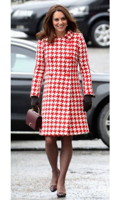 For the Karolinska Institute visit, Duchess Kate wore a red and white houndstooth coat by Catherine Walker and carried a quilted Chanel handbag.