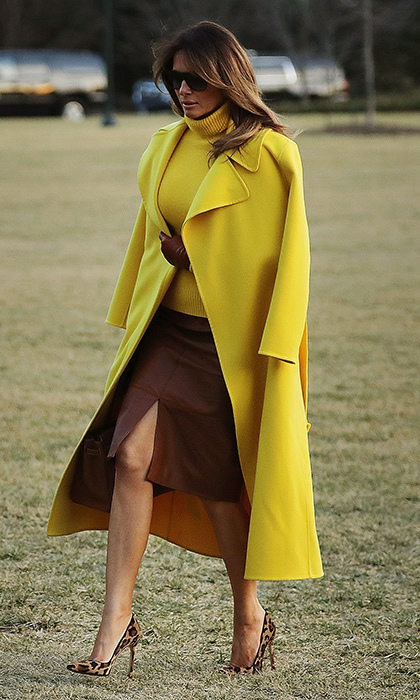 Melania rocked a yellow $5,000 Ralph Lauren coat and Pierre Herve leather pencil skirt as she returned to the White House after a day trip to Cincinnati, Ohio on February 5. The first lady took a walk on the wild side thanks to her sky-high leopard print heels.