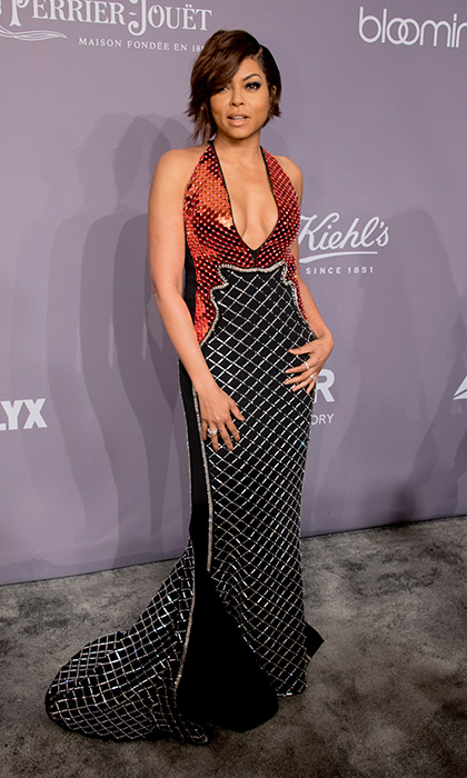 The night's host, <I>Empire</I> star Taraji P Henson, brought some serious glam with her sequined red and black halter gown by David Koma.