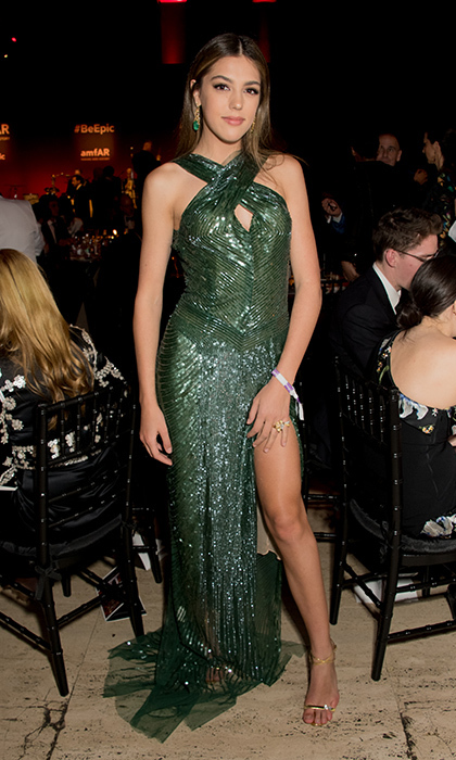 "Sly's daughter <a href=""https://us.hellomagazine.com/tags/1/sistine-stallone/""><strong>Sistine Stallone</strong></a> glittered in a forest green halter-necked dress and metallic sandals.