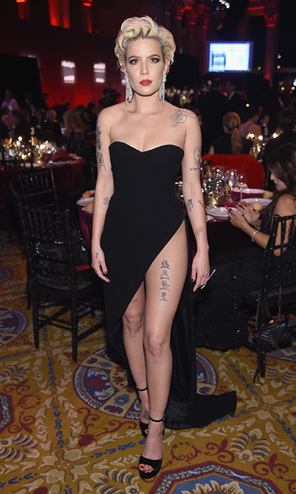 Thigh-baring gowns are a hot red carpet trend. Halsey, who performed for the amFAR gala, wore a strapless dress that showed off her many tattoos.