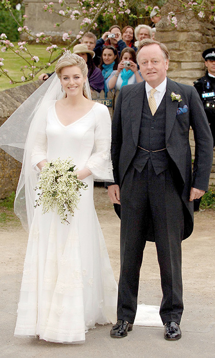 The bride arrived with her father Andrew Parker Bowles, who divorced Duchess Camilla in 1995, in a blue Bentley before he walked his daughter down the aisle.  