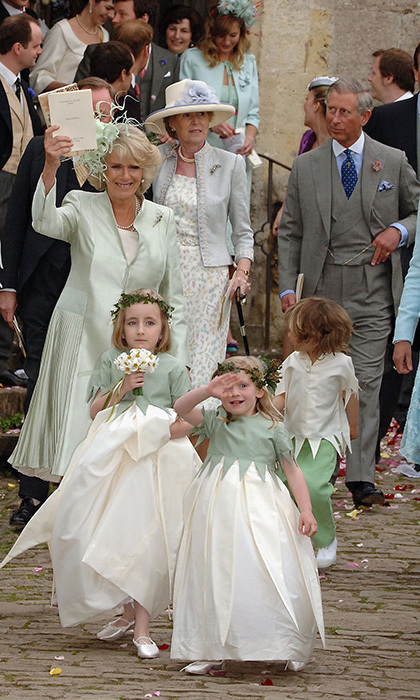 With husband Prince Charles in the background, mother-of-the-bride Duchess Camilla waved to the cheering crowds. 