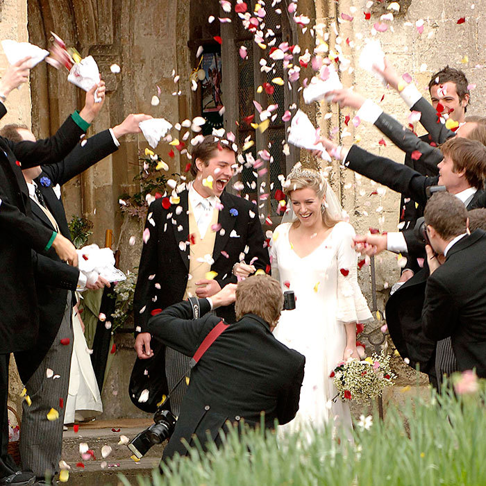 The church bells rang out and guests showered the newlyweds with flower petals as they emerged from the ceremony.