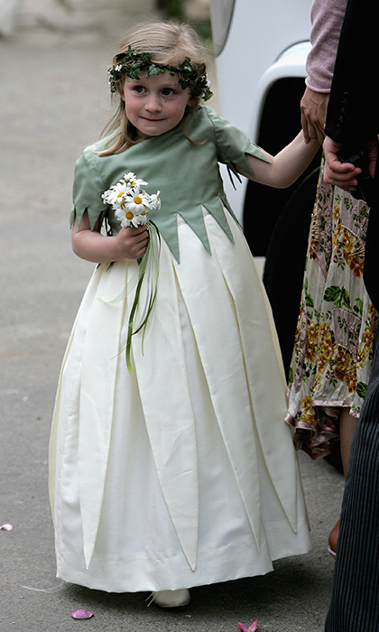 Each tiny bridesmaid held a mini-bouquet of daisies and wore a wreath in her hair.
