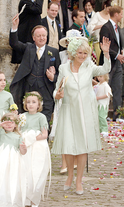 The Duchess was lovely in a mint green silk coat dress. Seen behind her, left, is the father-of-the bride.