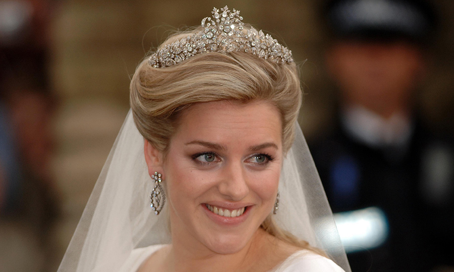 The bride wore a tiara belonging to Duchess Camilla's family anchoring her elegant upswept hairstyle. 