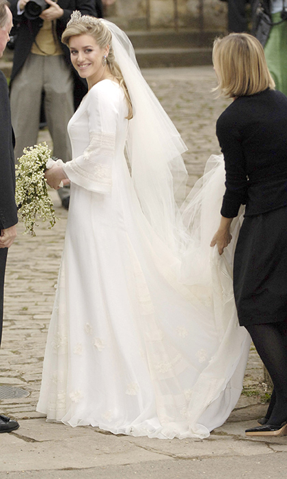 In that moment the crowds got the first glimpse of the bride's dress: an ivory layered silk chiffon gown by Robinson Valentine, who designed the outfits for her mother's wedding to Prince Charles in 2005.