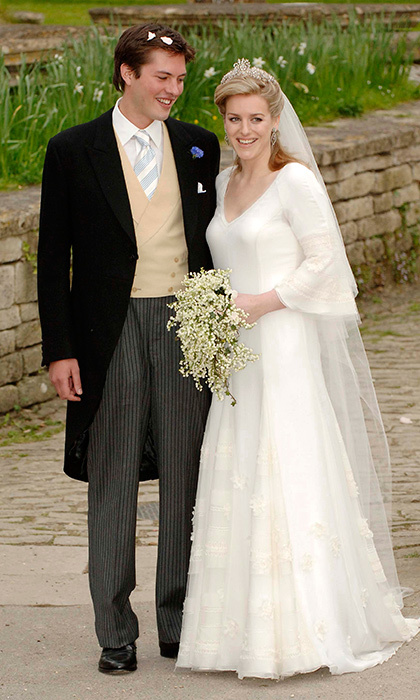 The bride, clutching her sweet bouquet of lily-of-the-valley, joined her new husband – still with the congratulatory petals in his hair – outside the church.