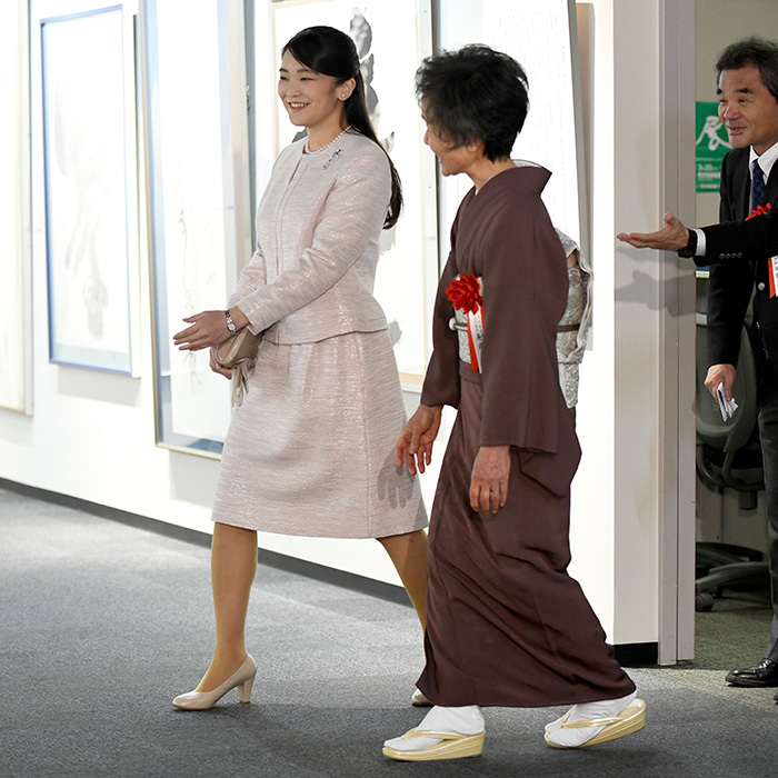 Japan's Princess Mako, who postponed her 2018 royal wedding earlier in the week, looked cheery as she stepped out for a calligraphy exhibition in Tokyo on February 9.