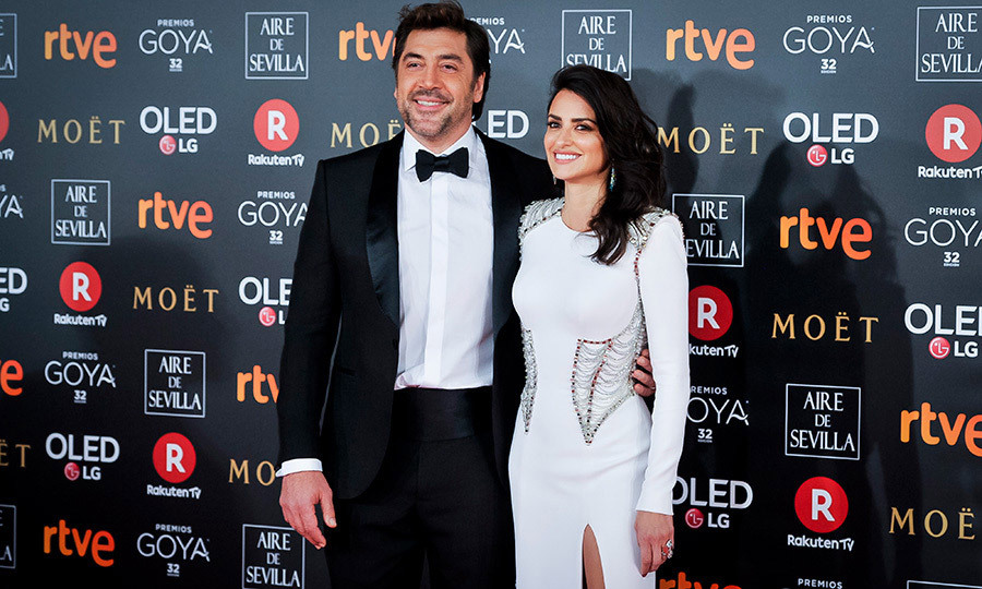 Hollywood couple Penelope Cruz and Javier Bardem dazzled on the red carpet of the Spanish Oscars, the Goya Awards, in Madrid. The <I>American Crime Story: Assassination of Gianni Versace</I> actress stunned, appropriately enough, in a Versace gown, while her husband looked dapper in a handsome tuxedo.