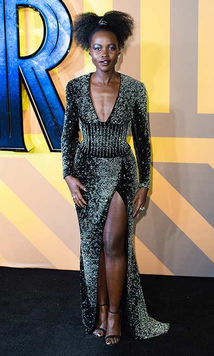Continuing her own <I>Black Panther</i> premiere circuit style streak, co-star Lupita Nyong'o rocked a sexy metallic look by Balmain at the London screening.