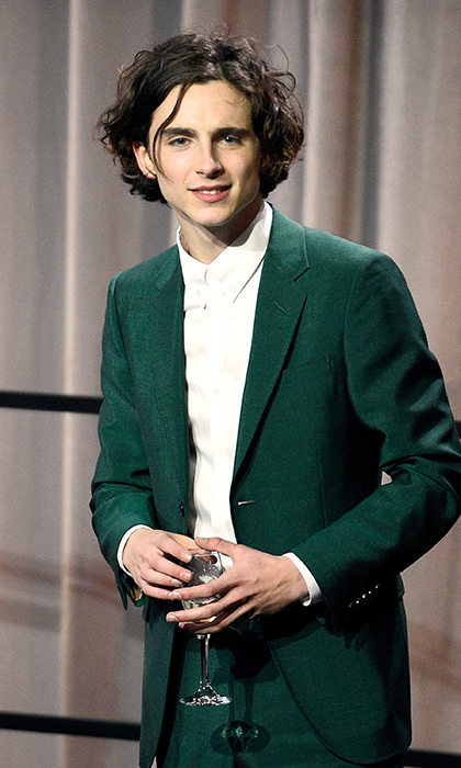 Timothee Chalamet, 22, nominated for his role in <I>Call Me By Your Name</i>, was ready for his close-up at the Oscars lunch in a tailored green suit. 