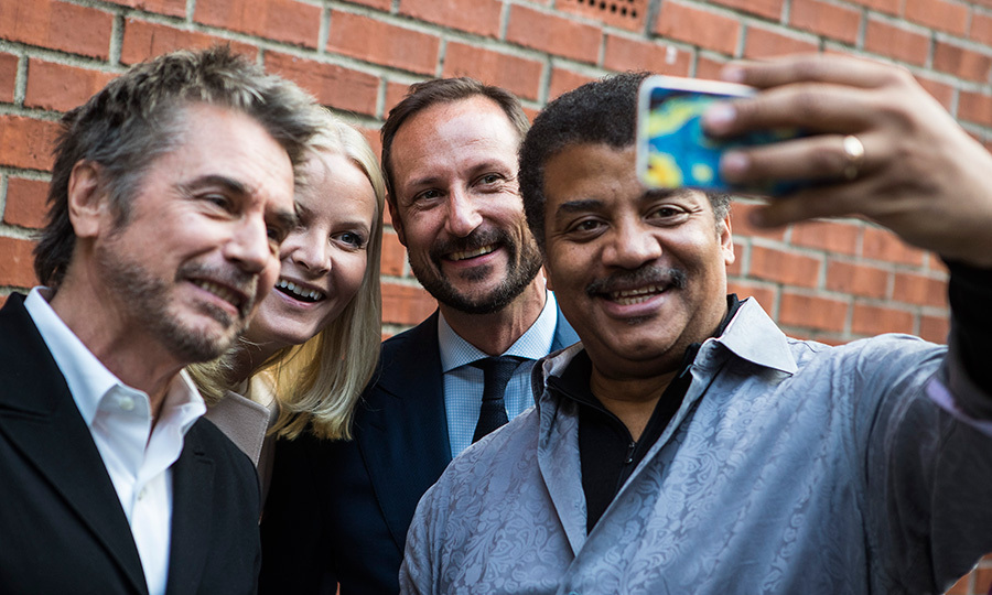 When celebrities and royals collide! Cosmos' Neil de Grasse Tyson, right, snapped a selfie with French musician Jean-Michel Jarre and Norway's future king and queen Crown Princess Mette-Marit and Crown Prince Haakon of Norway during the Starmus Festival on June 20, 2017 in Trondheim.