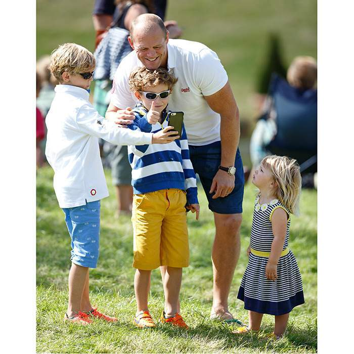 "Hey guys, what's going on? Queen Elizabeth's great-granddaughter <a href=""https://us.hellomagazine.com/tags/1/mia-tindall/""><strong>Mia Tindall</strong></a> seemed enthralled with dad Mike Tindall as some young friends helped him snap a pic for posterity at the Festival of British Eventing in August 2016.
