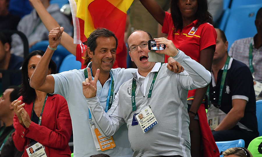 Go team! Prince Albert of Monaco, right, got into the spirit with a pal during the Spain vs Brazil basketball match during the 2016 Rio Olympics. 