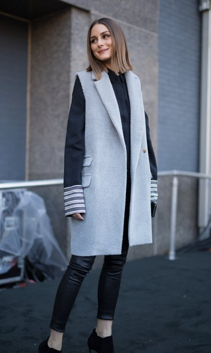 Olivia Palermo kept it simple in grey and black on her way to the Colovos and Noon By Noor shows at NYFW on February 8. 