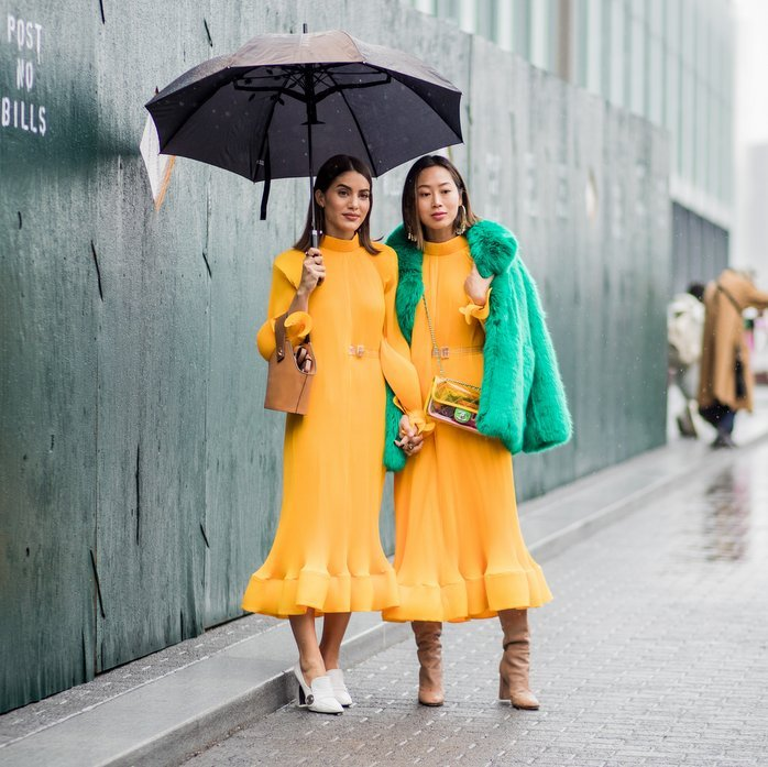 Thanks to their bright matching yellow dresses, style influencers Camila Coelho and Aimee Song brought some sunshine to the rainy streets of New York City outside the Tibi show on February 11.