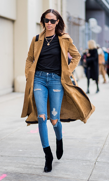 Supermodel Joan Smalls showed that simple and classic is also ridiculously cool in torn jeans, a black t-shirt and suede trench.
