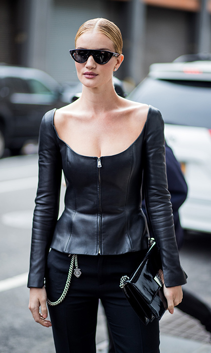 Model-actress Rosie Huntington-Whiteley, also a guest at Ralph Lauren, showed off her tougher side in a zip-front leather top and chain details.