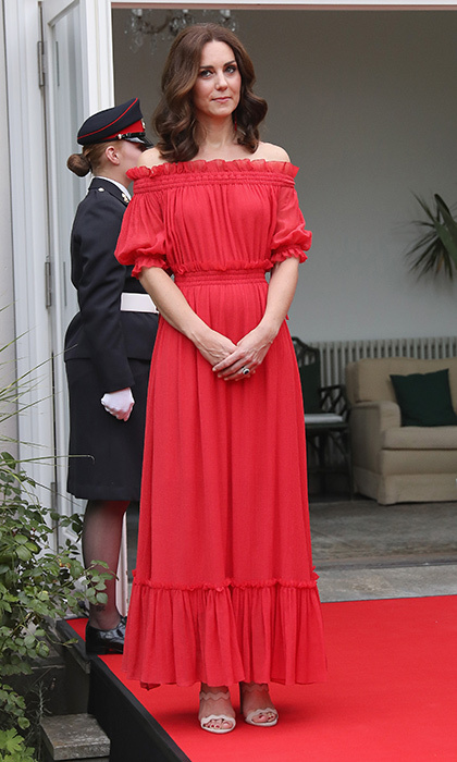 While in Berlin on a royal tour of Germany with Prince William, Duchess Kate wore one of her most romantic red looks ever – an off the shoulder ankle-length Alexander McQueen dress with ruffle details.