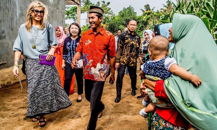 Queen Maxima of the Netherlands smiled at an adorable baby while walking through corn fields in Lampung, Indonesia on February 12.
