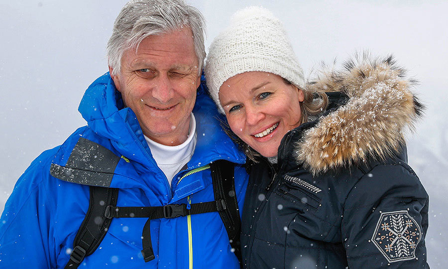 King Philippe and Queen Mathilde of Belgium stopped for a snowy photo during their family's holidays in Switzerland on February 12. 